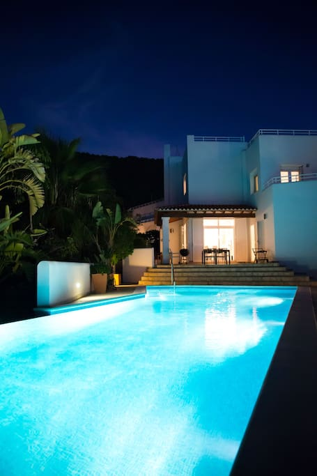 house and pool by nights
