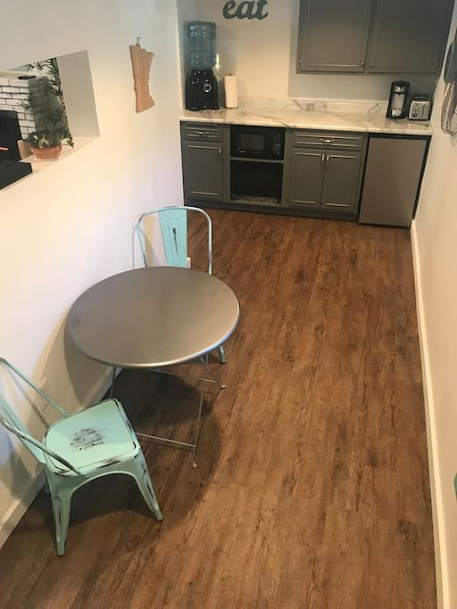 Kitchenette is stocked with basics including can opener, corkscrew, bottle opener and scissors.  K-cup coffee provided along with disposable plates, bowls, cups, mugs, napkins, cutlery.
