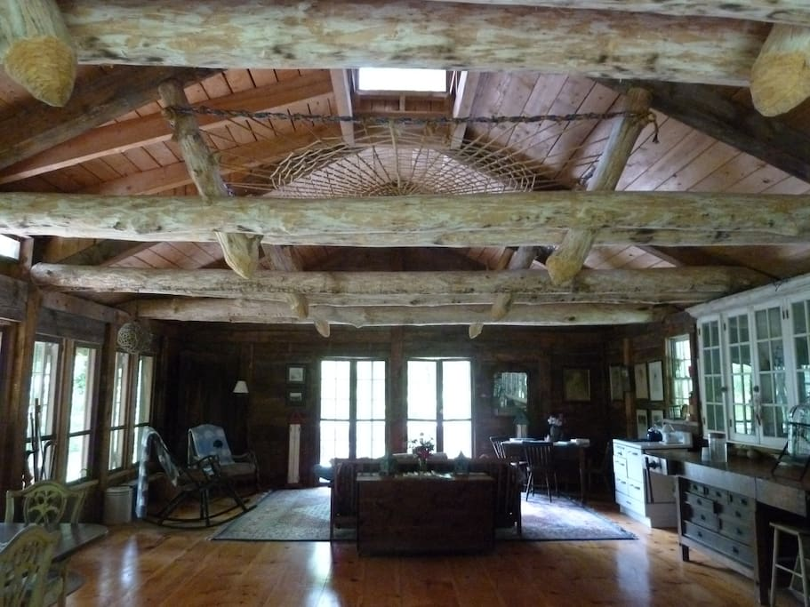 This one room cabin features a strong spider web in the rafters!