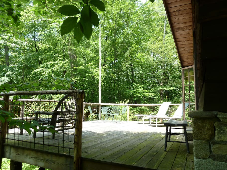Outdoor deck for sunbathing and bird watching by day and star gazing at night.