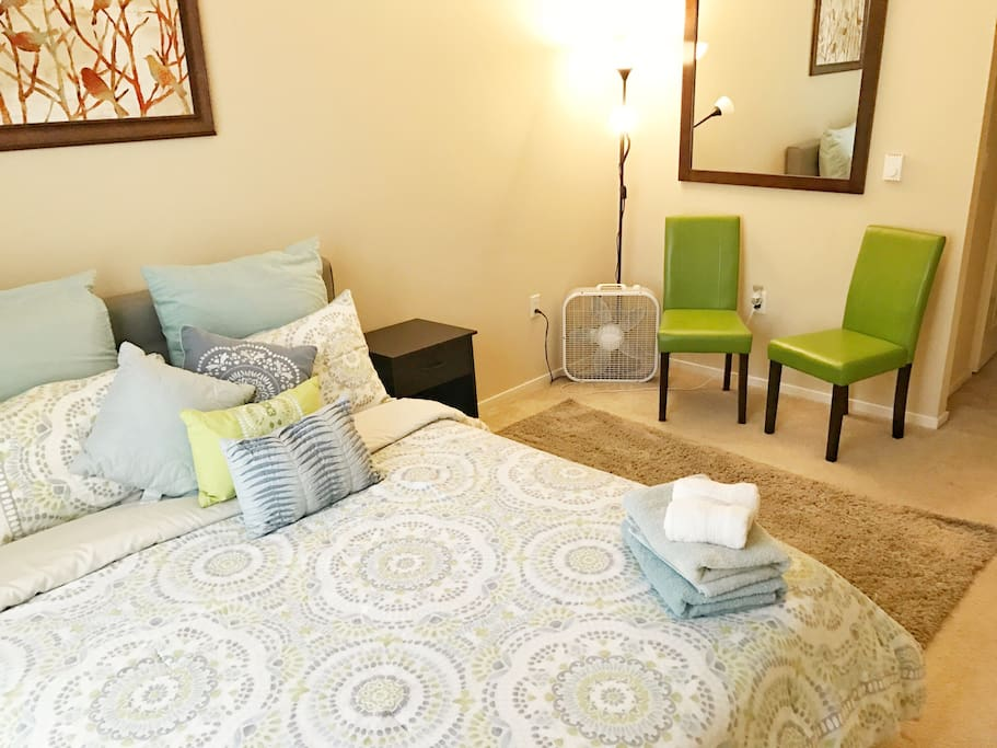 Luxurious queen bed in master bedroom, with private bathroom access