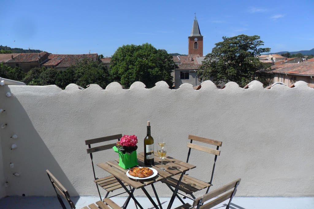 The view of the church spire in the distance from the terrace in St chinian.