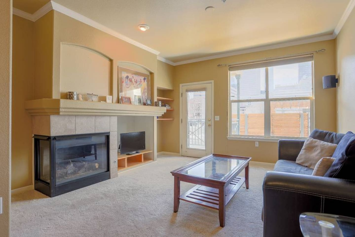 A view of the living room with access to back patio area. Here you can relax, watch TV, read or access the patio (overlooks downtown Denver).