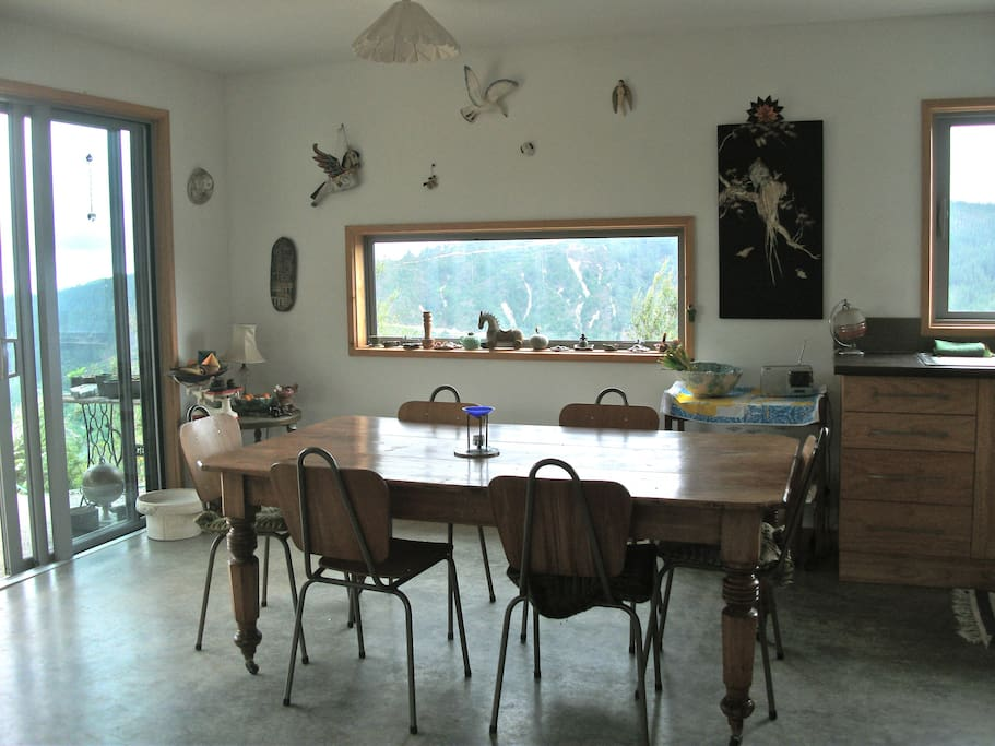 Views in every direction from the open-plan dining and kitchen