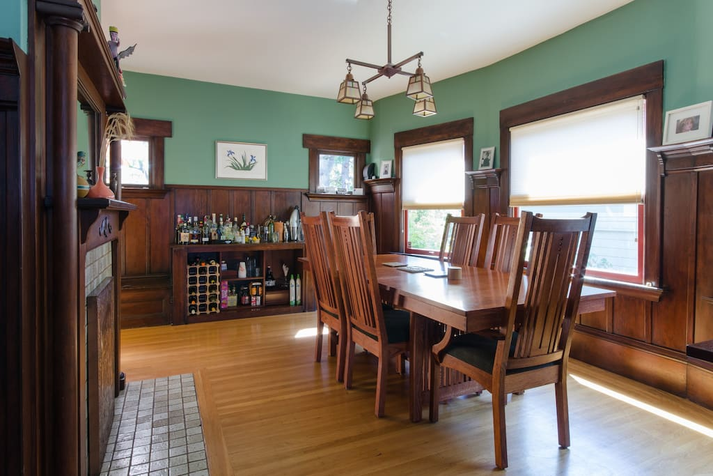Full dining room with original wainscoting, craftsman table/chairs and chandelier