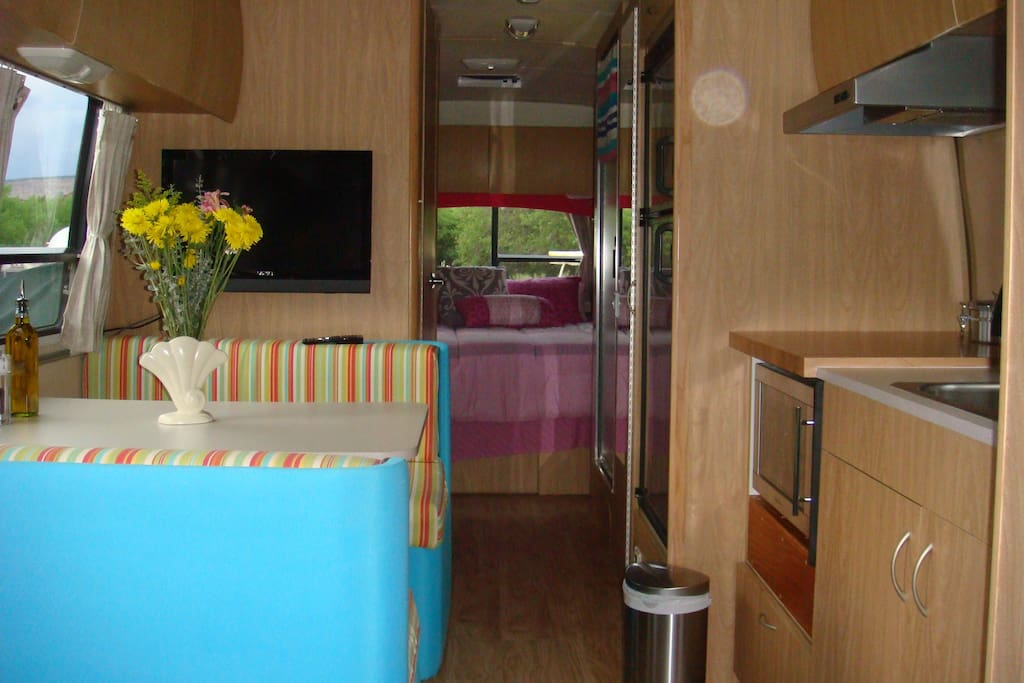 Kitchen table with booth seating that also converts to a bed.