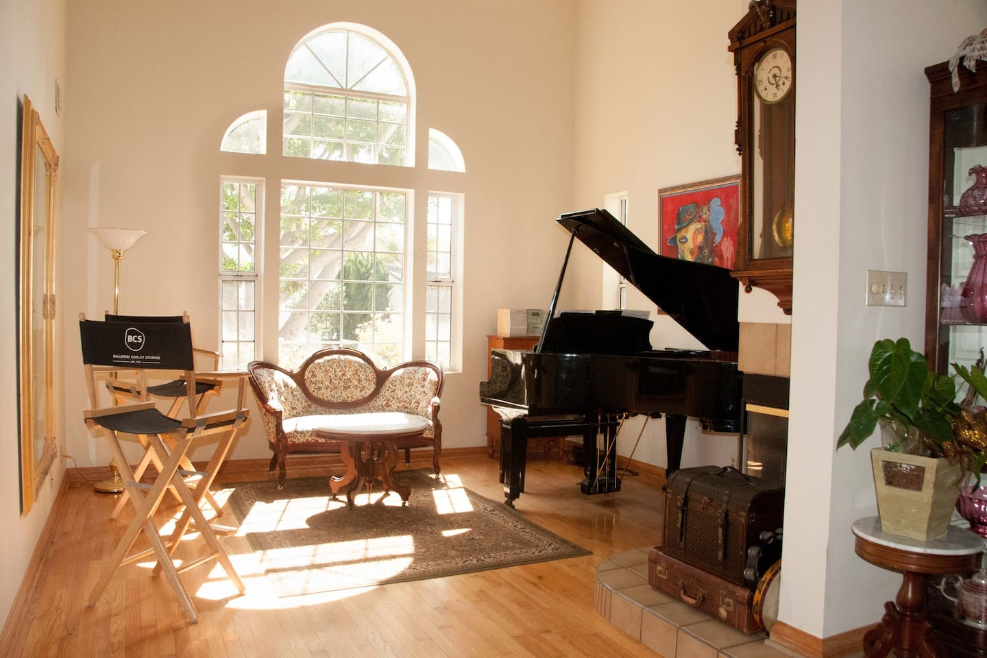 The Piano Room. Notice the tambourines in front of the fireplace under the clock. This is also the best room for dancing;)
