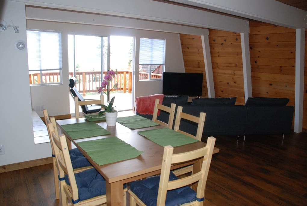 Living room and front deck have an epic view of the lake.