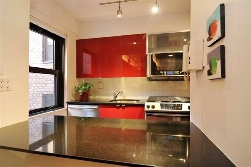 Newly renovated kitchen with gas range, dishwasher, and refrigerator/freezer.
