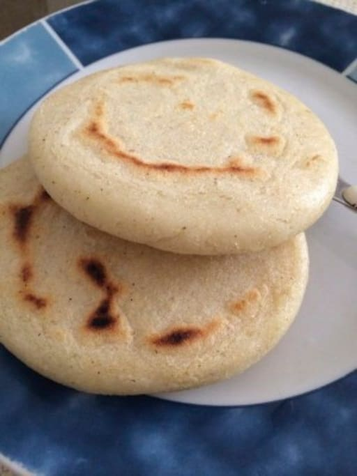 Venezuelan Arepas, The tipycal breakfast, my mom and grandma will make you! if you are interested they can teach you how to make it too.