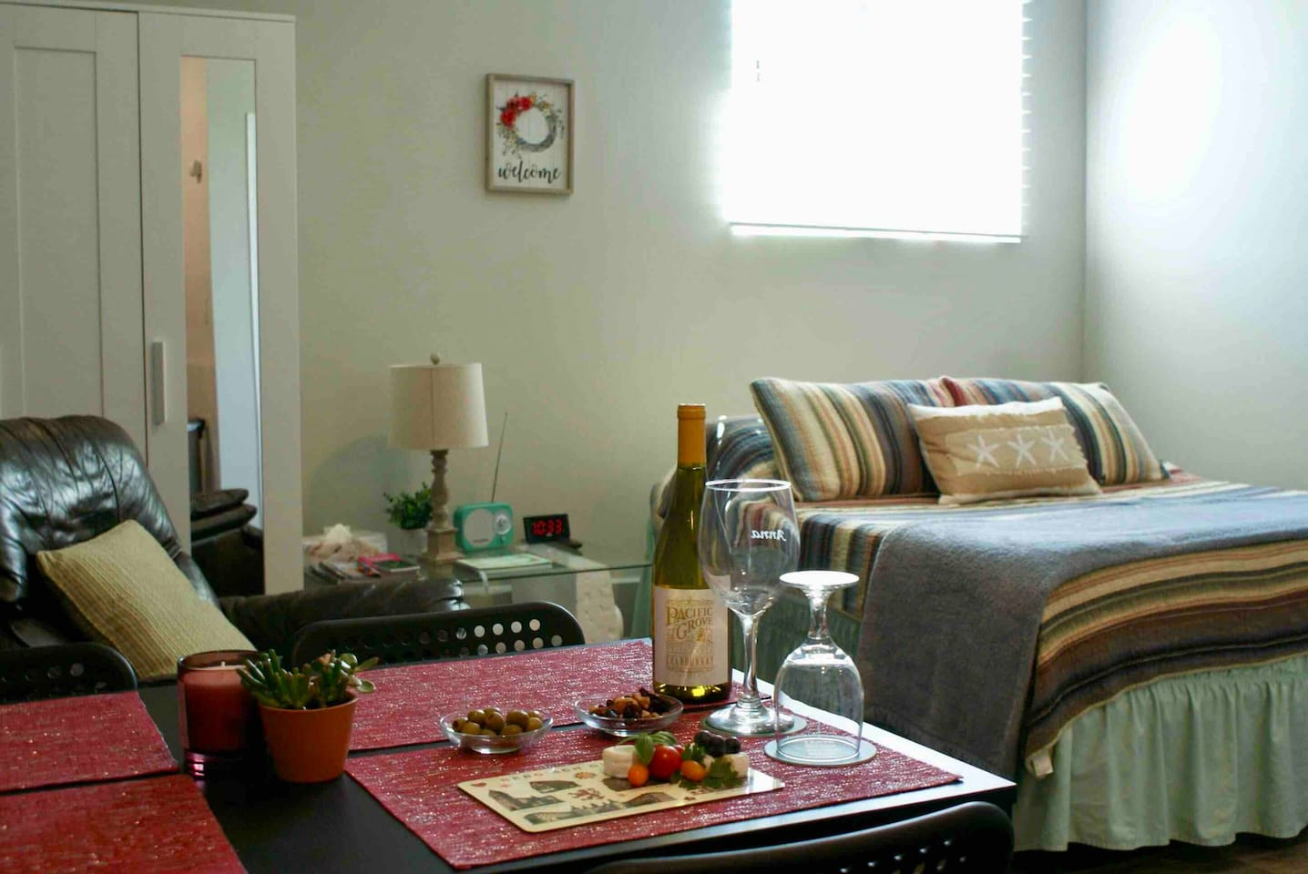 Main living space, table with four chairs, comfortable leather recliner, queen size bed!