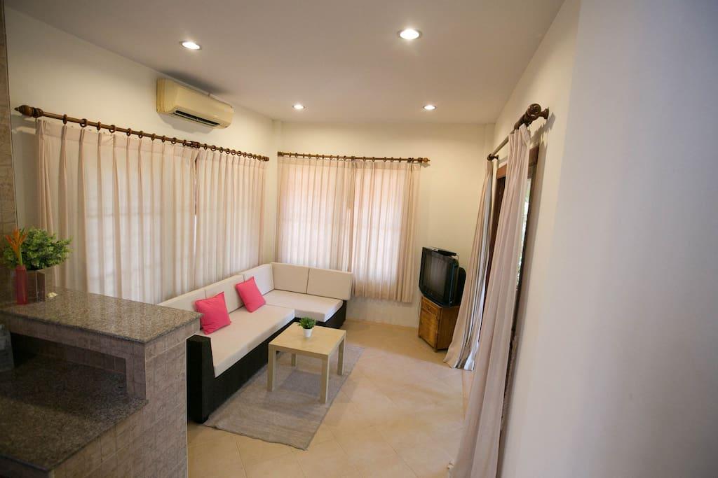 living room with comfortatble sofa.