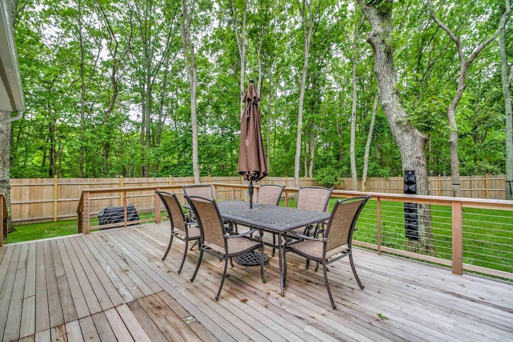 French doors lead out to the expansive deck and private fenced yard.
