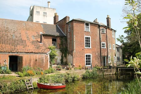 Idyllic riverside house and gardens