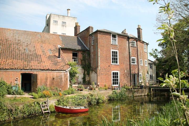 Idyllic riverside house and gardens