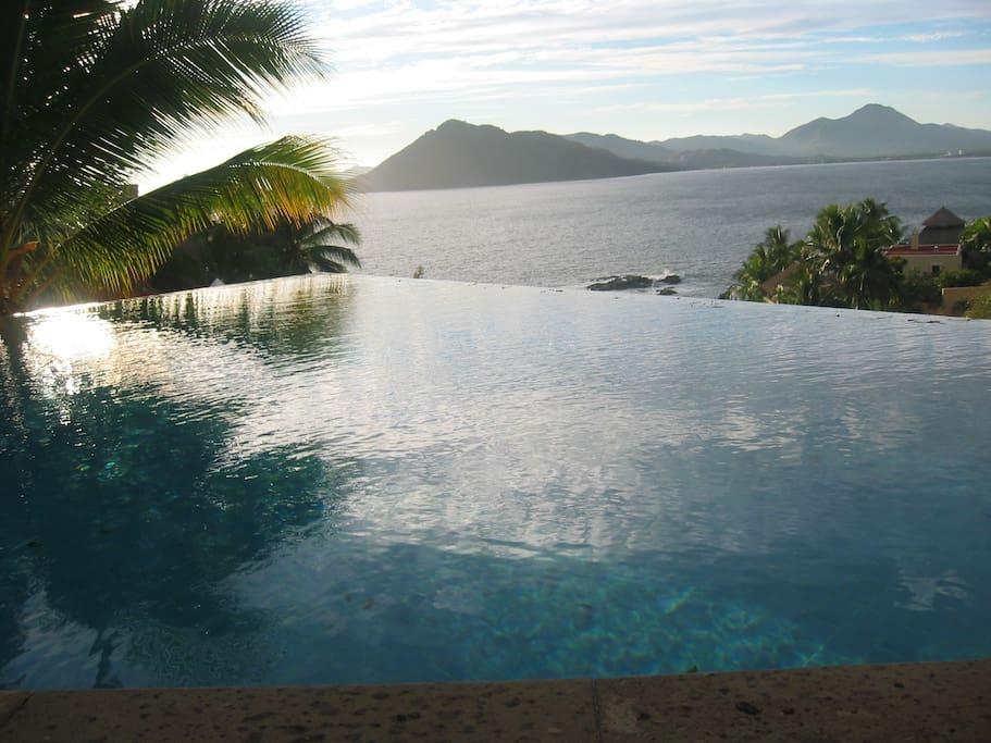 Upper infinity pool overlooking Bay and Ocean