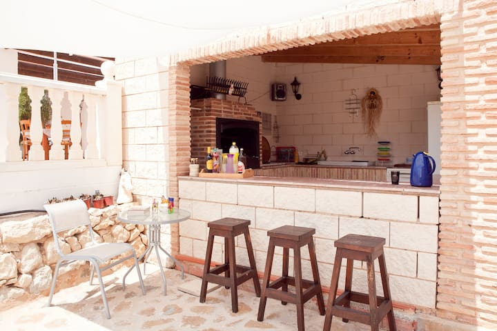 have a drink at  the  bar .     Guests are welcome to sit at the bar, wth use of fridge/freezer etc.  Unfortunately the main BBQ is not  for guests to use but  Don't worry we have a portable BBQ for you to use during your stay,