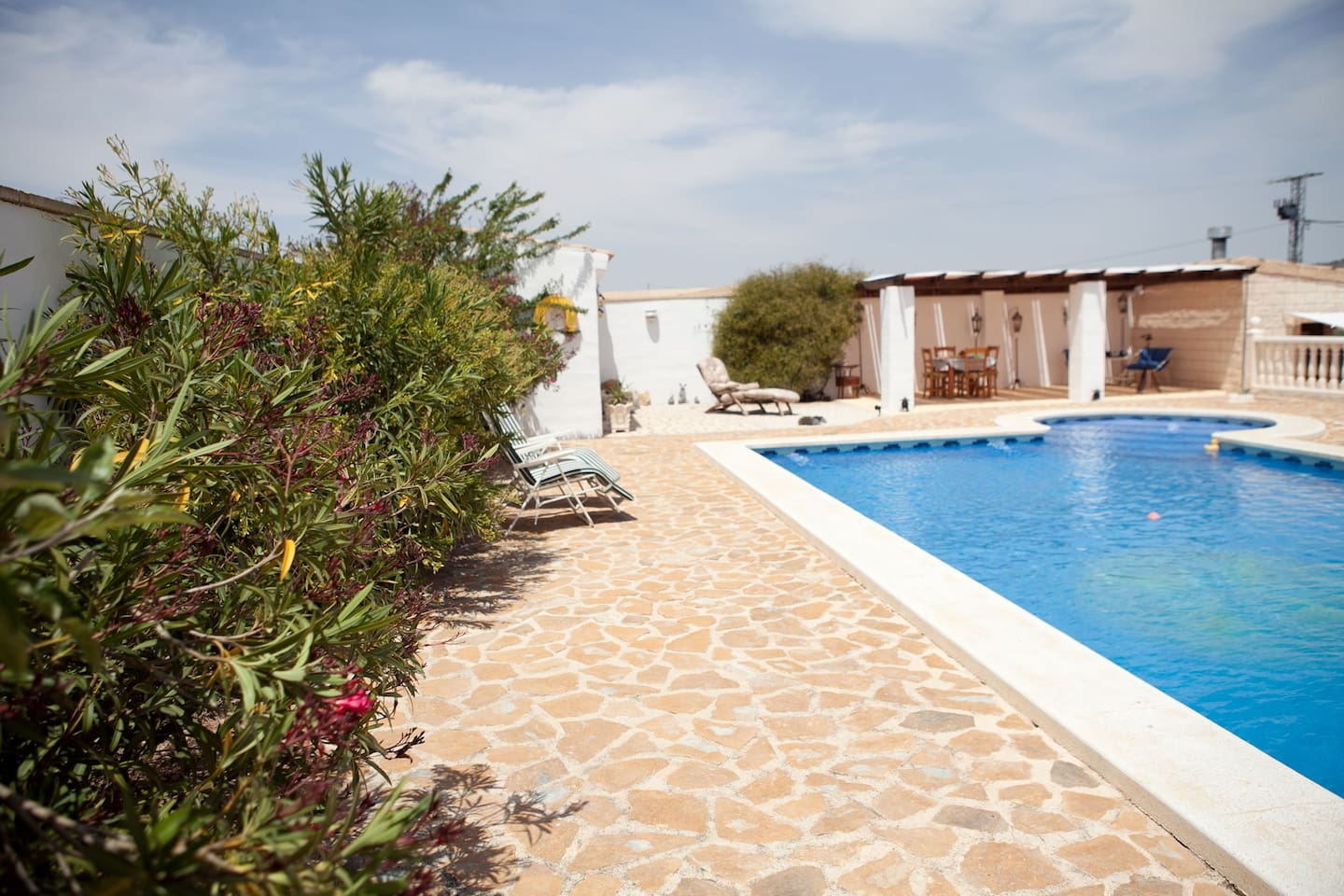 Your comfort is our priority .    Plenty of loungers and chairs for your use by the pool
