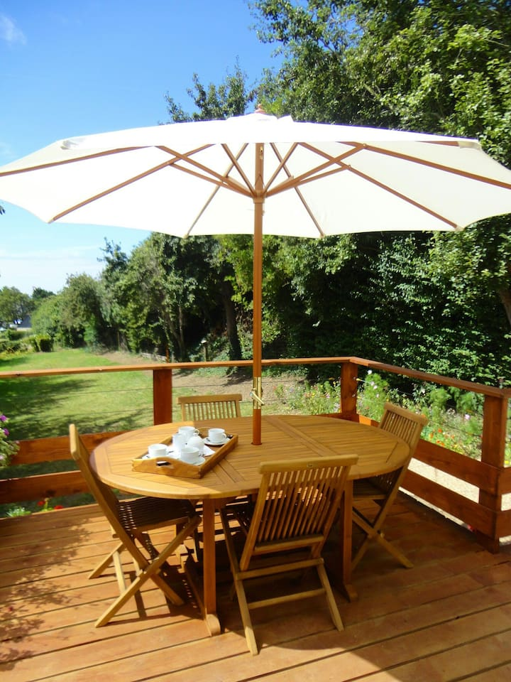 The timber decked terrace, complete with solid teak garden furniture.