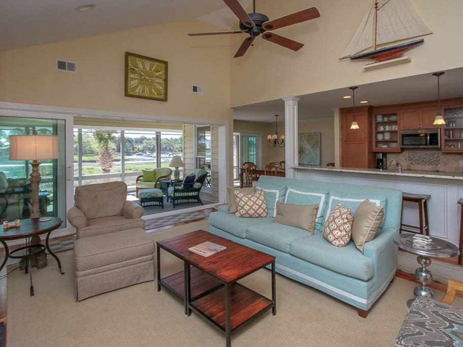 Living Room Leads into Sunroom with Water Views at 38 Lands End