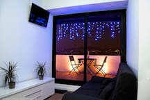 LIVING ROOM NIGHT VIEW TOWARDS THE SAGRADA FAMILIA & WITH DOUBLE SOFA BED 140x200cm