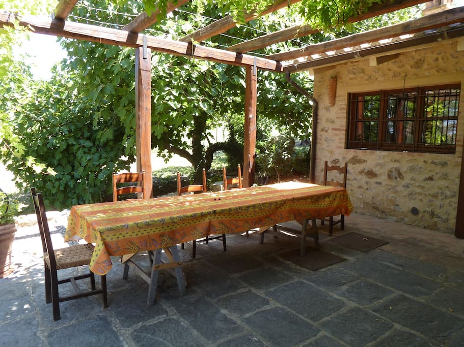 Outside dining under the pergola