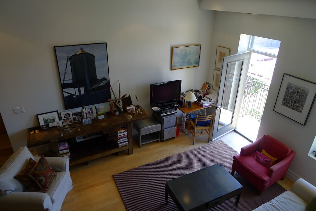 View of living area with door to private balcony