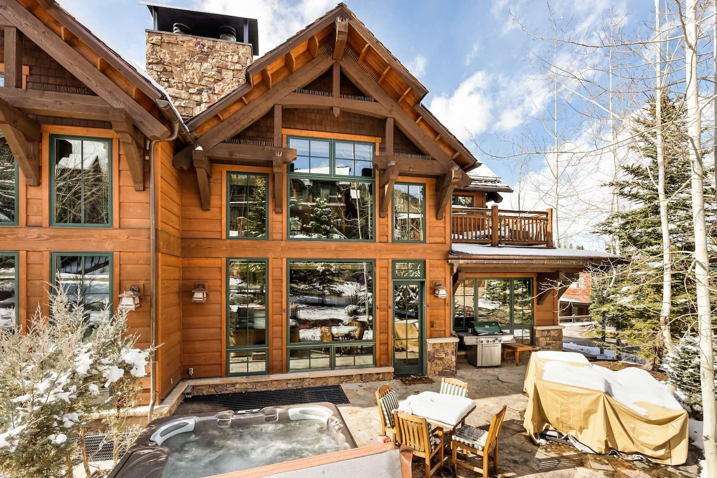 The outdoor patio of your vacation homes has a gas grill, private hot tub and small dining area you can enjoy.