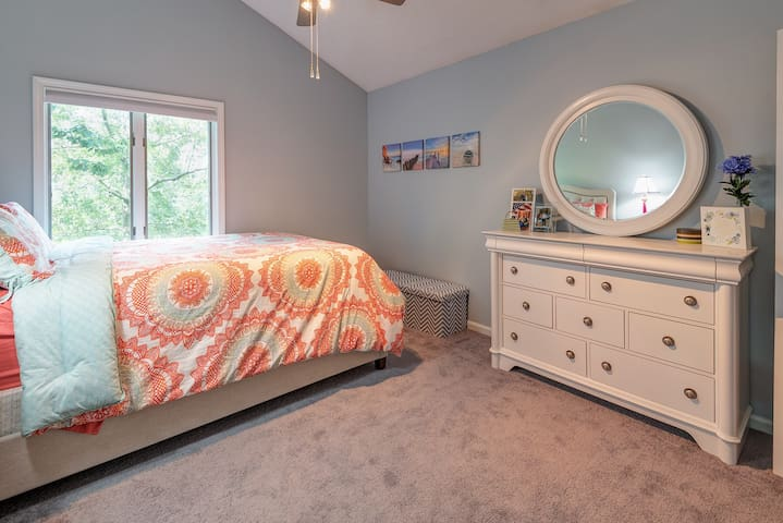 Beautiful, light-filled bedroom with queen bed.