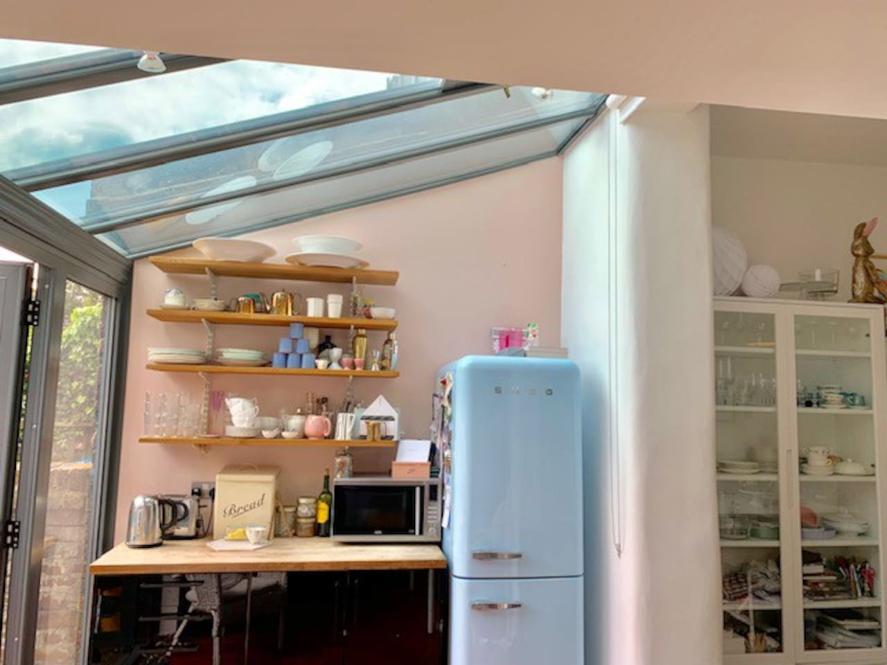Open plan kitchen with semi glass roof and double doors out to the garden. The kitchen is well equipped with dishwasher.