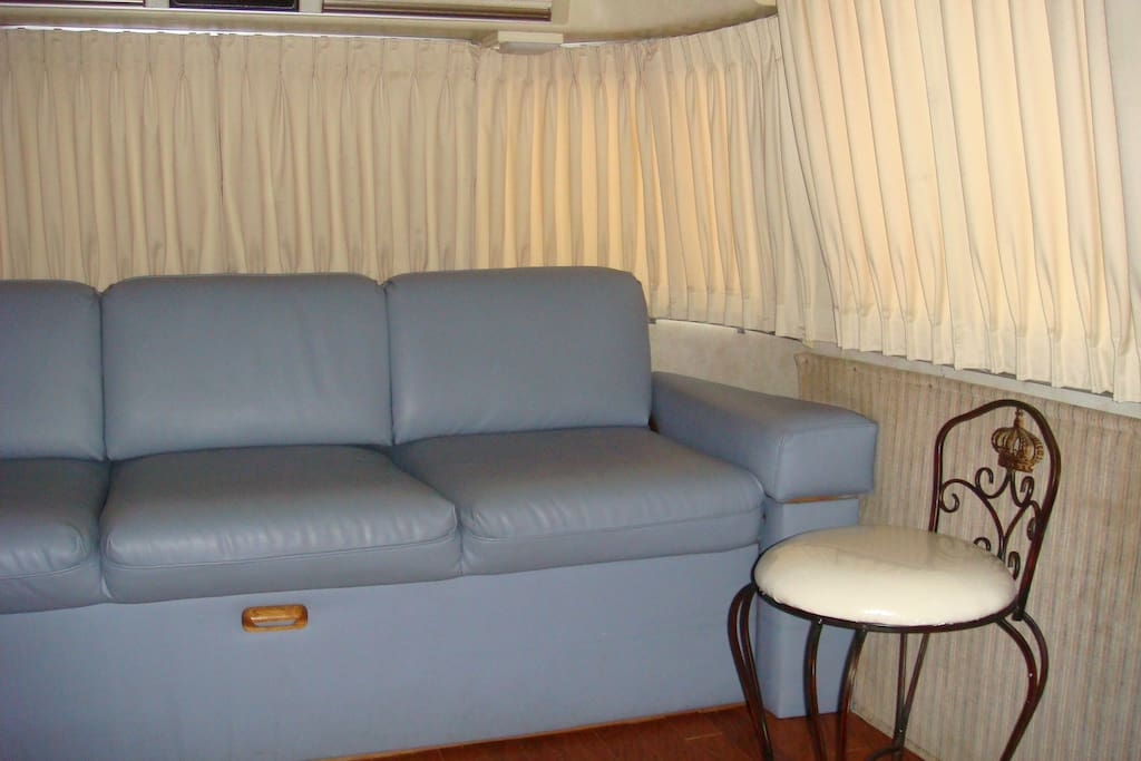 Comfortable couch in the lounge area, which converts to a hide-a-bed