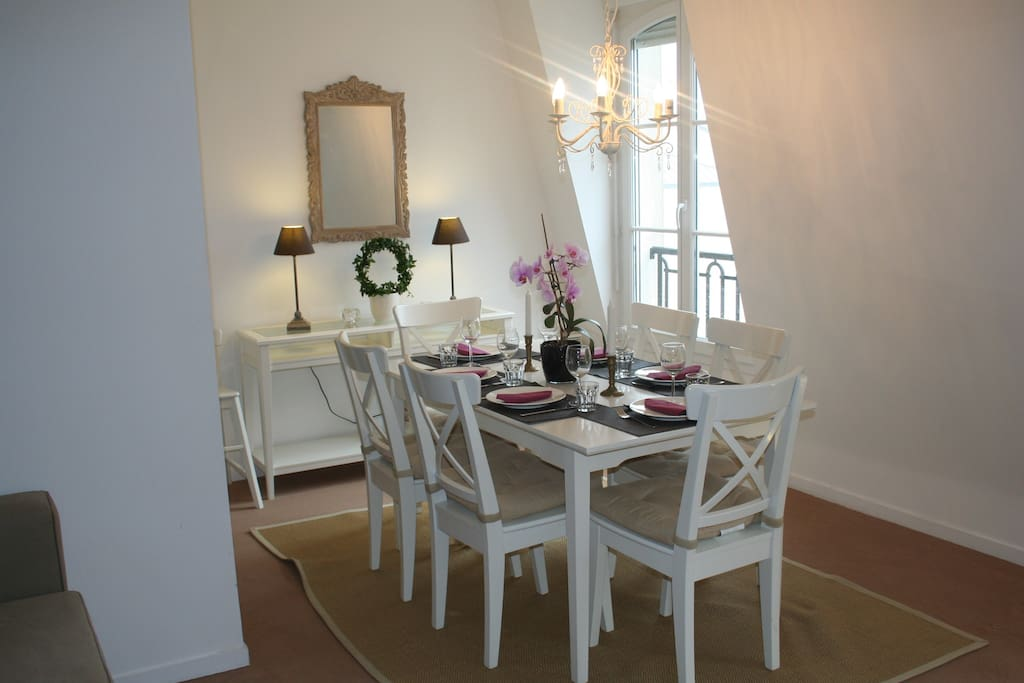 Dining space with a extendable table sits 8