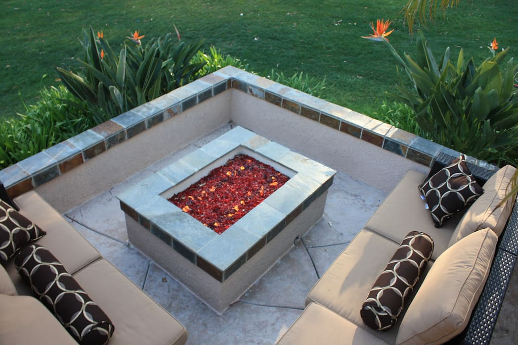 Sip wine by the fire pit as you overlook the beautiful park at sunset
