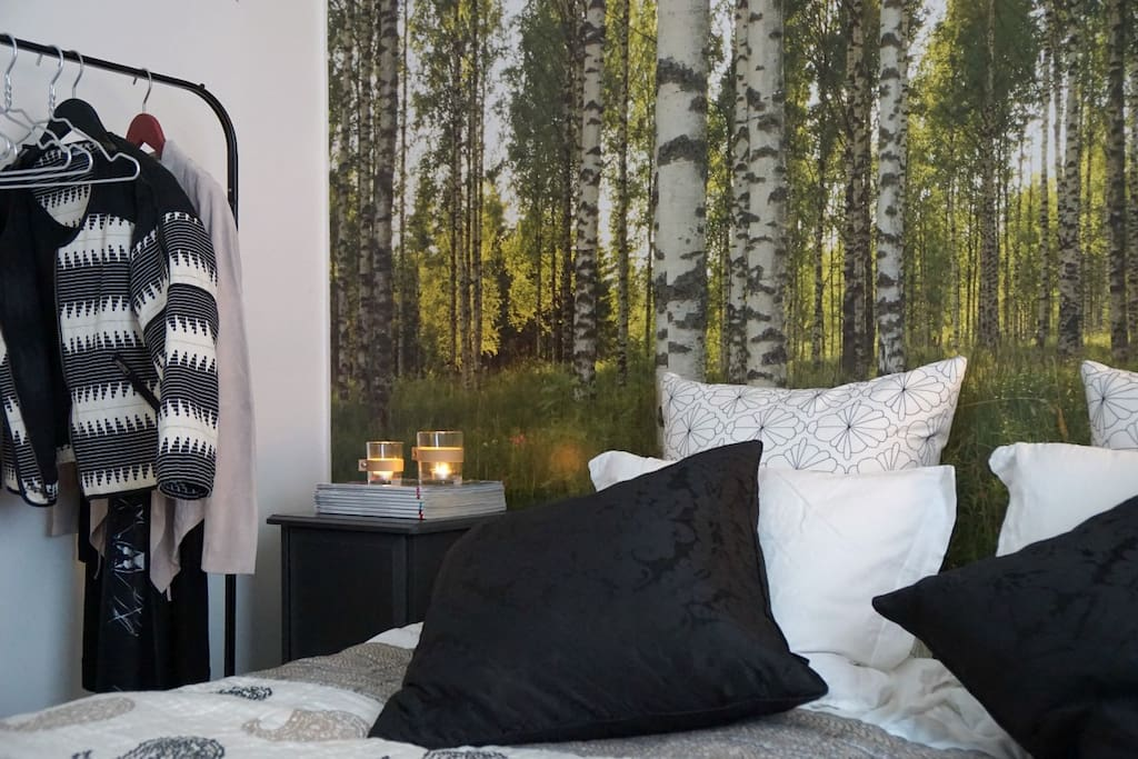 Small bedroom with a limited space for luggage