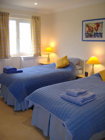 Russet twin bedroom, with direct access to parking and with en suite sho9wer room.