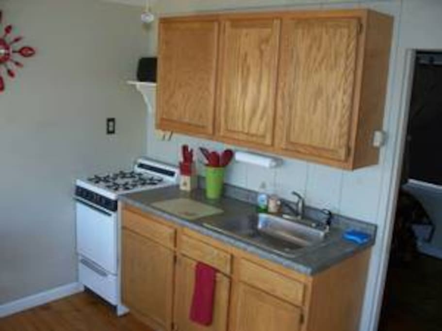 Kitchen / Living Room - Stove , Cabinets