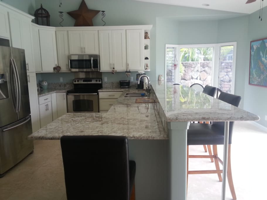 Huge Fully Furnished Kitchen with electric stove and dishwasher.