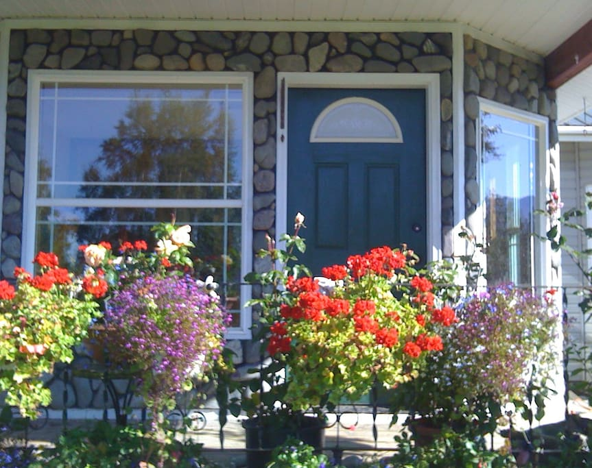 The front porch awash in flowers