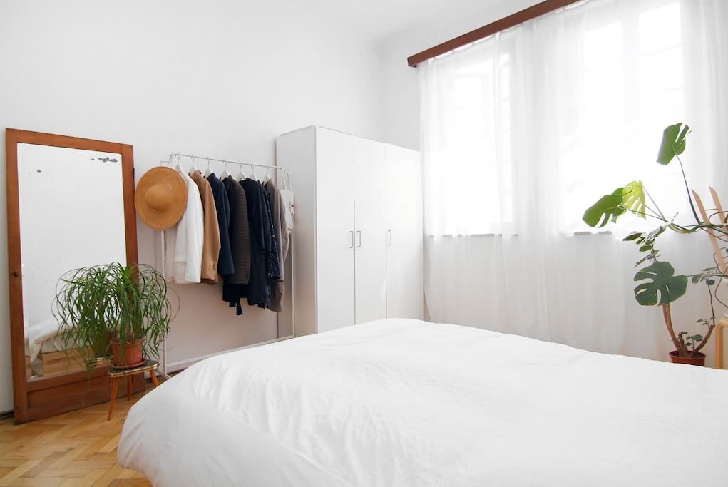 Bright and airy bedroom, full body size mirror