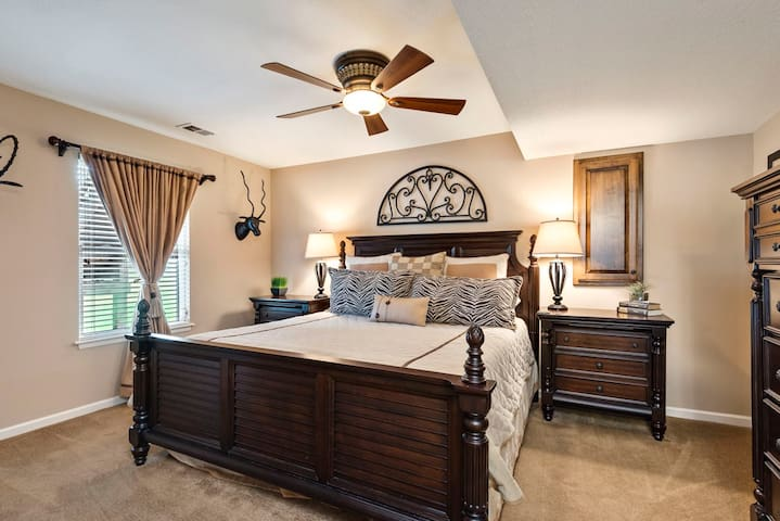 The third master bedroom with beautiful ornate furnishings and large king bed