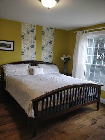 Master bedroom with king bed. Faces east and a beautiful sunrise each morning.