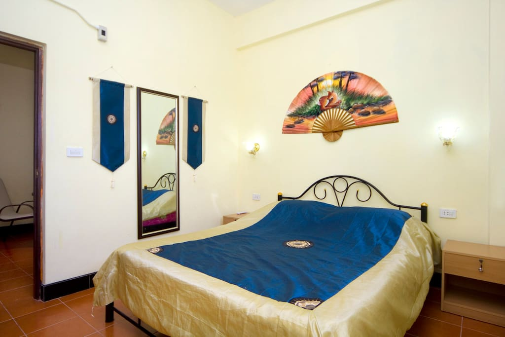 Room with double bed and air conditioning