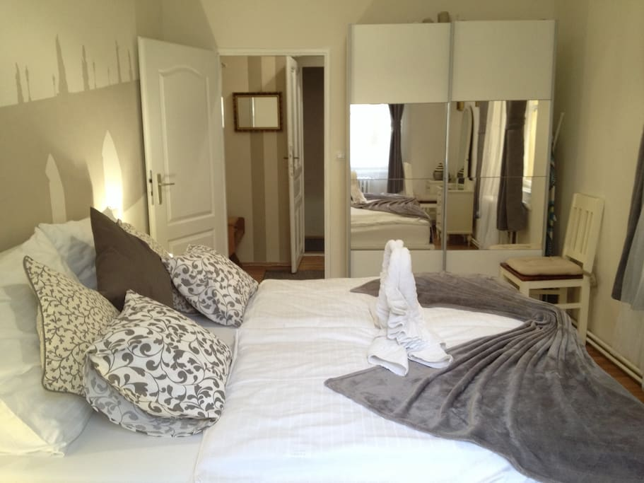 The  bedroom is quite room with comfortable king-size double bed,  wardrobe.