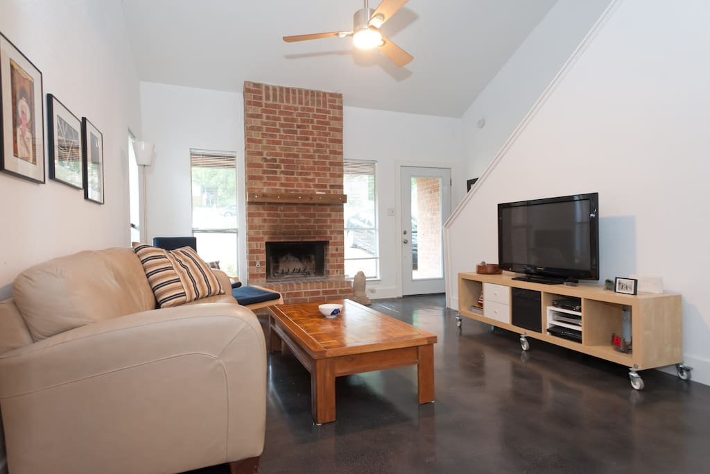 Vaulted ceiling creates on open and relaxing space.  Wood burning fireplace.