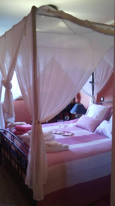 Romantic bedroom with baldaquin