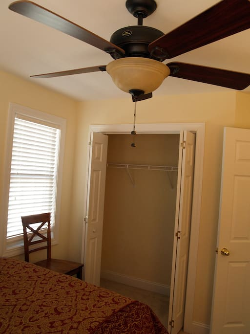 View of the Guest Room closet and ceiling fan.