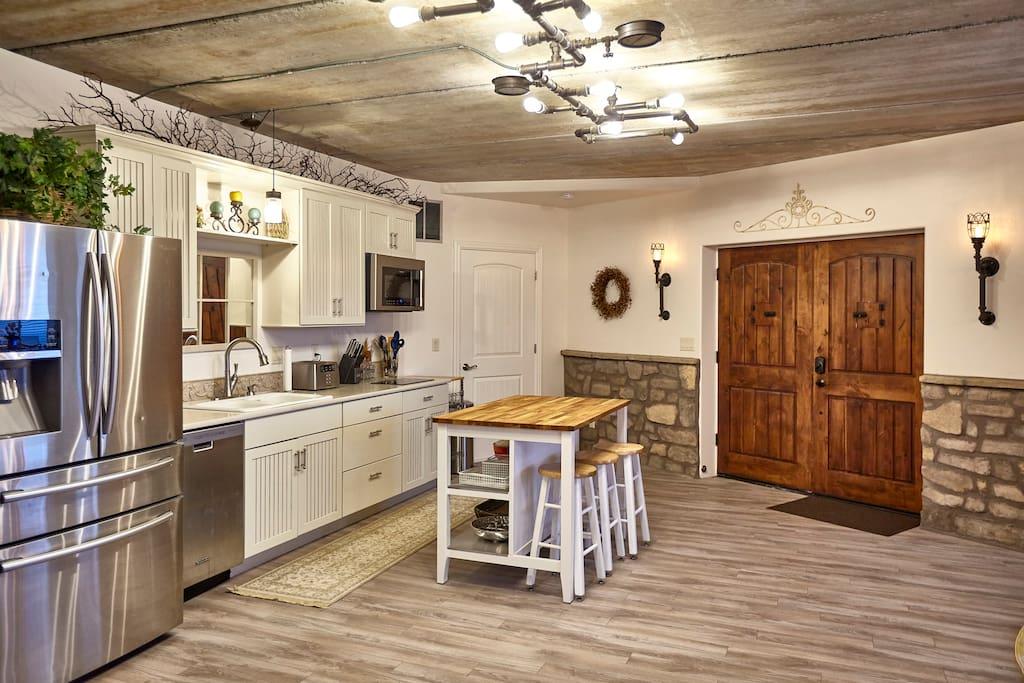 "Custom Designed ""Steam Pipe"" lighting in Kitchen/Entrance Area"