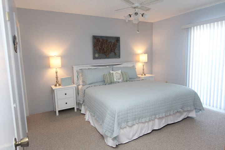 Master bedroom with King size bed and deck entrance.