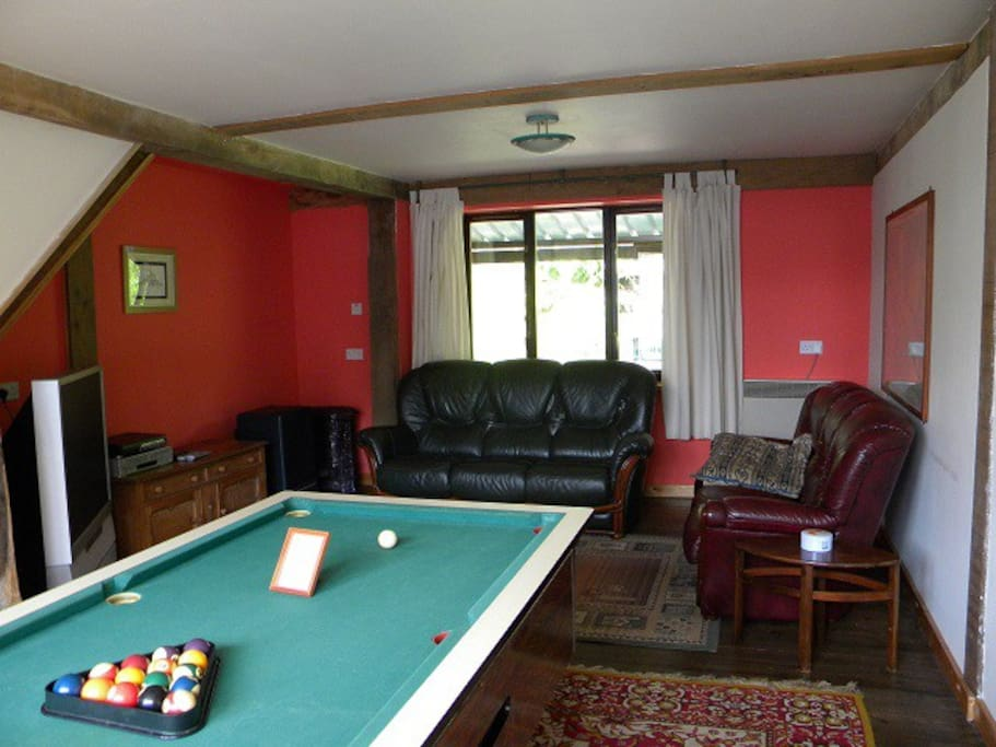 Lounge with pool table, TV, DVD, Video player, DVD's and videos