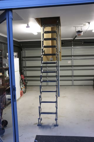 Staircase ladder access to studio at entrance
